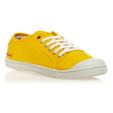 Tennis unies en toile jaune