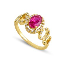 Bague en or ornée de diamants et de rubis - or